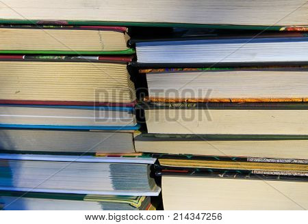 Many new books on a shelf. Books background