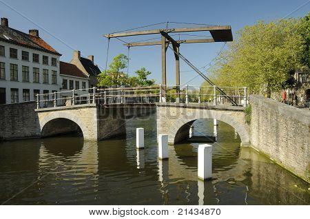 A Bridge Over A River In Brugge In Belgium