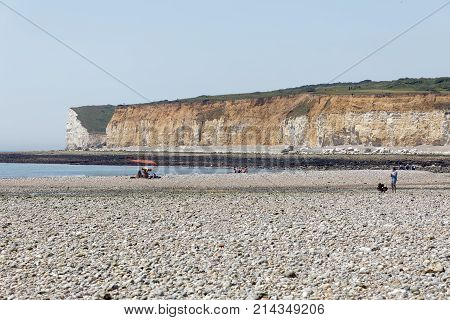 SUSSEX GREAT BRITAIN - JUN 18 2017: People visiting the white chalk cliffs in the Seven Sisters Country Park. June 18 2017 in Sussex Great Britain