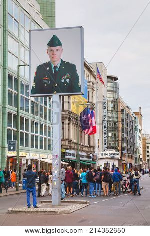BERLIN - AUGUST 21 2017: Checkpoint Charlie on August 21 2017 in Berlin Germany. The name was given by the Western Allies to the best-known Berlin Wall crossing point between East and West Berlin during the Cold War.