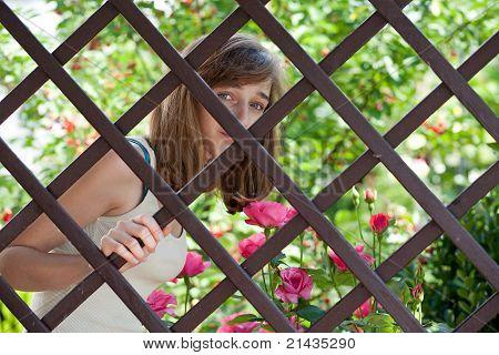 Teenage Girl Behind A Fence