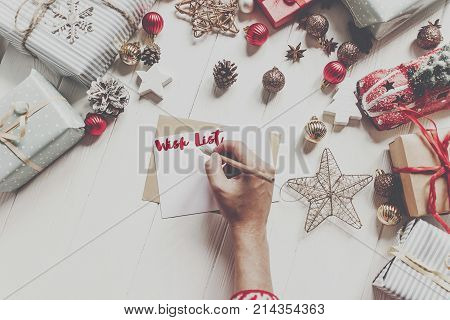 Wish List. Hands Holding Pencil And Writing A Letter Wish List To Santa Claus With Space For Text. C