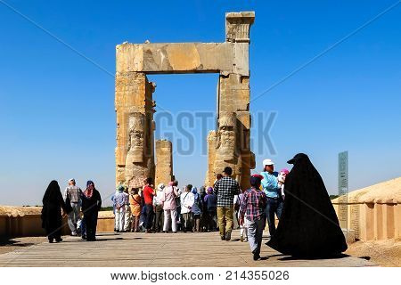Iran Shiraz Persepolis - September 18 2016: tourists and locals visiting the old ruins of the ancient city. Gate of all nations. Ancient Persia.