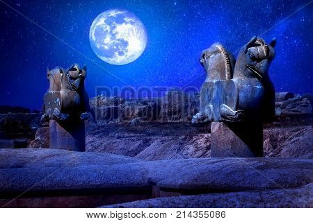Stone column sculpture of a Griffin in Persepolis against a moon and stars. The Victory symbol of the ancient Achaemenid Kingdom. Iran. Persia. Shiraz. Artistic night image.