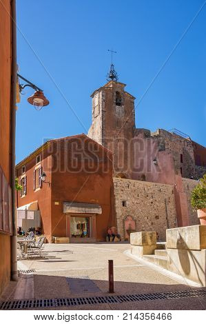 ROUSSILLON FRANCE - APRIL 27 2016: Street of medieval village of Roussillon. It ochre village is included in list of