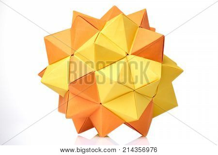 Modular origami model on white. Yellow and orange, 3D spiky ball. Visual art, geometry, paper folding.