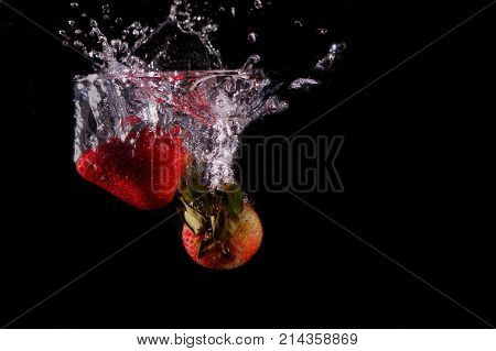 Strawberries drooped in a pool of water.