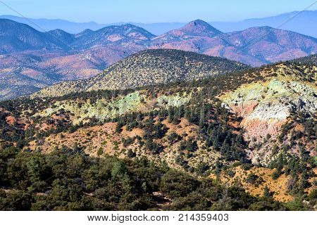 Barren and desolate mountain ridges with chaparral shrubs and Pinyon Pine Trees taken in the rural Southern Sierra Nevada Mountains, CA