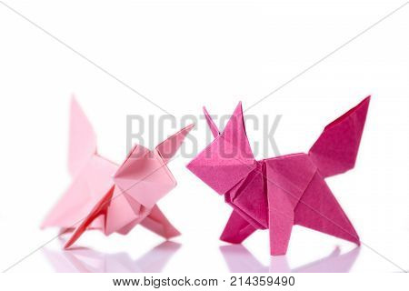 Set of animal origami models made of pink colored paper. Arts lesson, school project for exhibition.