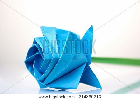 Beautiful blue flower origami. Learning art of folding paper. Child's project dedicated to International Women's day.