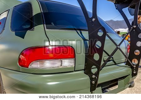 Rear Spoiler Built On A Flat Green Car
