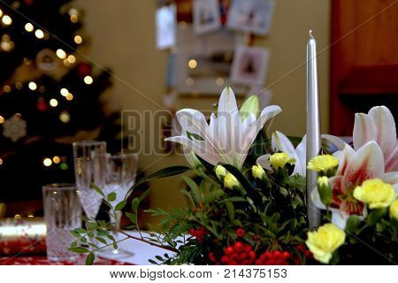 Beautiful Floral Centerpiece With Candles On A Festive Dining Table Laid Ready For Christmas Dinner