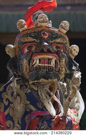 Huge dark blue Tibetan ancient Mask with human skulls above for sacred Buddhist rituals Himalayas India.