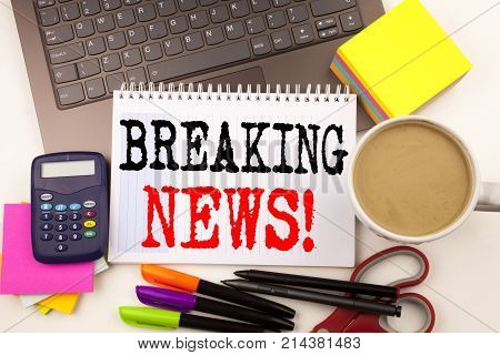 Word Writing Breaking News In The Office With Surroundings Such As Laptop, Marker, Pen, Stationery,