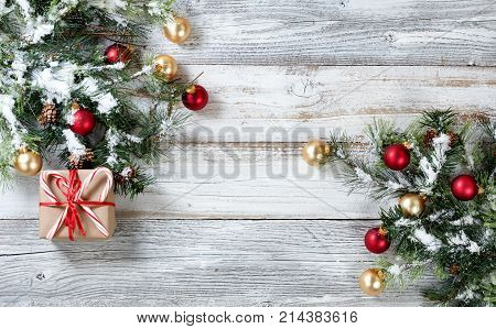 Gift box with decorated Christmas Rough Fir Tree on Weathered White Wooden Background