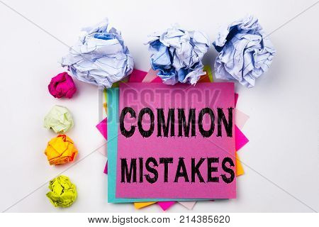 Writing Text Showing Common Mistakes Written On Sticky Note In Office With Screw Paper Balls. Busine