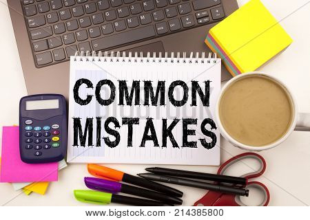 Word Writing Common Mistakes In The Office With Surroundings Such As Laptop Marker Pen Stationery Co