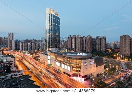 Chengdu, China - July 19, 2017 : WanXiangCheng mall aerial view at dusk with 2nd ring highway in the foreground in the eastern suburb of Chengdu city.