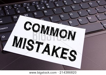 Writing Common Mistakes Text Made In The Office Close-up On Laptop Computer Keyboard. Business Conce