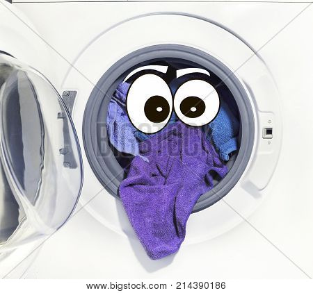 A close up of a washing machine loaded with clothes. and eyes Laundry Personage