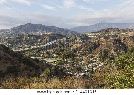 Afternoon view of Glendale hills homes and freeway near Los Angeles in Southern California.