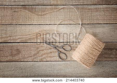 Hank of hemp twine on wooden background poster