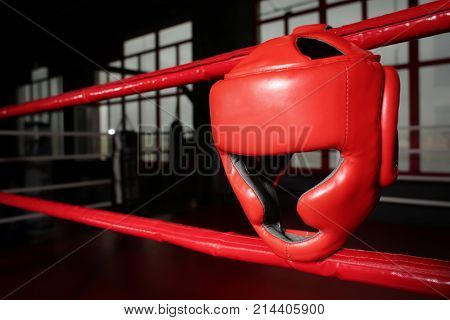 Headgear on ropes of boxing ring in gym
