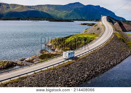 Caravan car RV travels on the highway Norway. Atlantic Ocean Road or the Atlantic Road (Atlanterhavsveien) been awarded the title as (Norwegian Construction of the Century).
