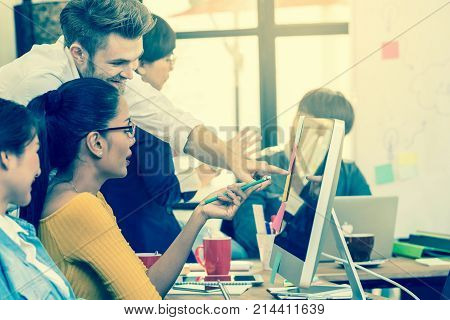 Group Of Asian and Multiethnic Business people with casual suit working in happy action with smart computer in the modern Office people business group concept