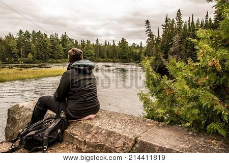 Girl Sitting Near Lake Of Two Rivers In Algonquin National Park Canada Ontario Natural Pinetree Land