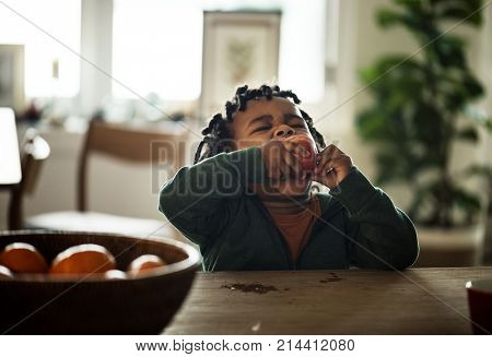 Black kid eating fruit