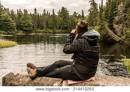 Girl With Binocular Sitting Near Lake Of Two Rivers In Algonquin National Park Canada Ontario Natura