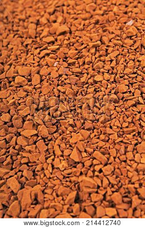 Instant coffee texture background. Brown coffee grains as mars floor stones. Instant coffee dry dried grains. Food photo.
