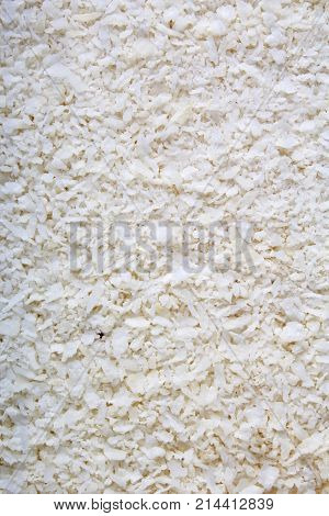 Desiccated coconut texture pattern as background. White abstract coconut coco cover background photo.