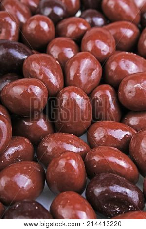 Dark and dairy chocolate balls. Chocolate drops as background texture pattern. Bon bons. Food.