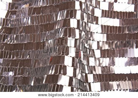 Sequin fabric. Sequins as background. Fashion sequin cloth closeup photo. Sequins pattern texture. Silver,