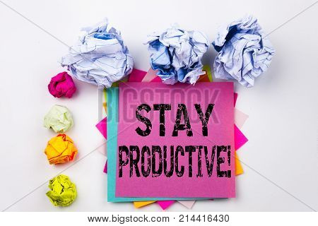 Writing Text Showing Stay Productive Written On Sticky Note In Office With Screw Paper Balls. Busine