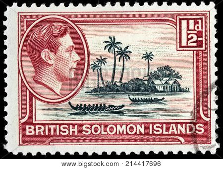 LUGA RUSSIA - OCTOBER 17 2017: A stamp printed by BRITISH SOLOMON ISLANDS shows view of artificial island Malaita - largest island of the Malaita Province in Solomon Islands circa 1939