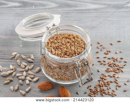 Homemade LSA mix in glass jar - Linseed or flax seeds, Sunflower seeds and Almonds. Traditional Australian blend of ground, source of dietary fiber, protein, omega fatty acids.