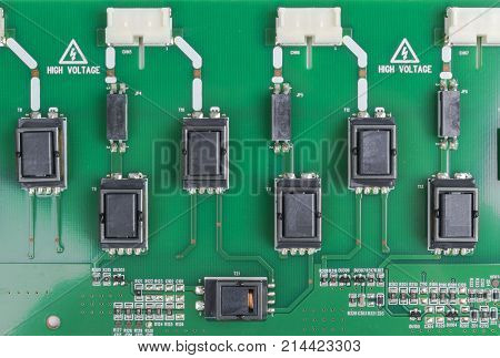 Circuitboard with resistors microchips and electronic components. Electronic computer hardware technology. Integrated communication processor. Information engineering component. Semiconductor. PCB