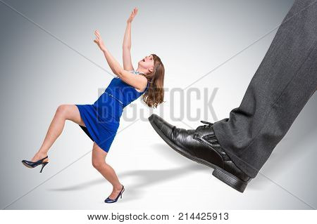 Businessman Big Foot Kicking Small Business Woman