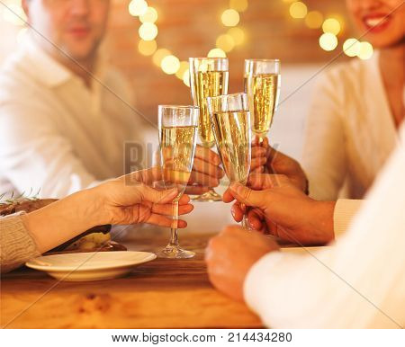 Champagne glasses in people hands. Party or celepration concept. Close up