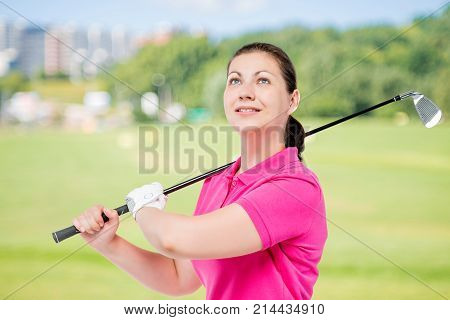 Horizontal Portrait Of A Successful Golfer With Equipment For Playing Golf On A Background Of Golf C