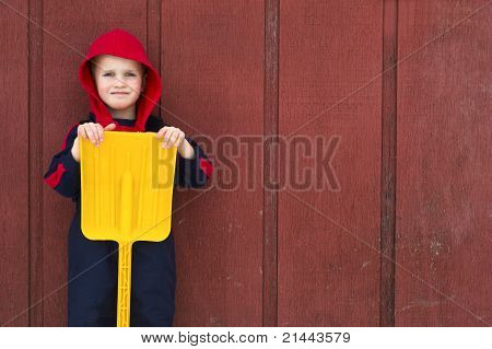 Young Boy With Yellow Toy Shovel