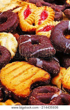 Cookies. Cookie crumpet tea biscuit pattern. Crumpets as background. Biscuits crumpet pattern texture. Chocolate coated biscuits. Sweets.