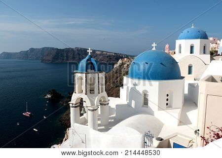 Blurred image of the famous 3 Blue Domes at Santorini.