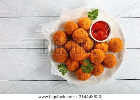 Delicious Potato Croquettes With Tomato Sauce