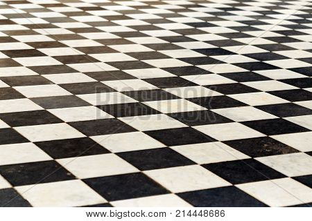 Floor Tiles On A Chessboard. The Perspective Is Black And White