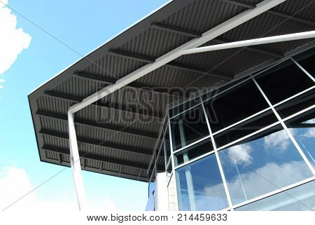 A modern steel and glass architectural feature.