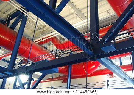 Section of pipe work used as both building support and as decorative architectural features.